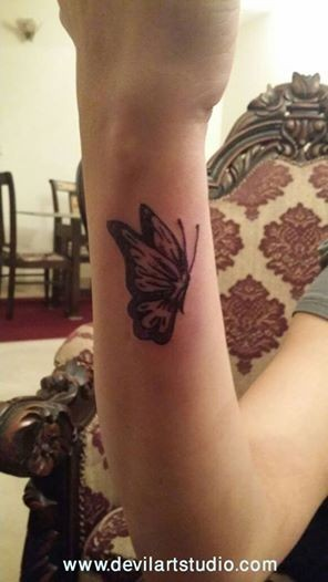 Butterfly tattoo done at devil art studio